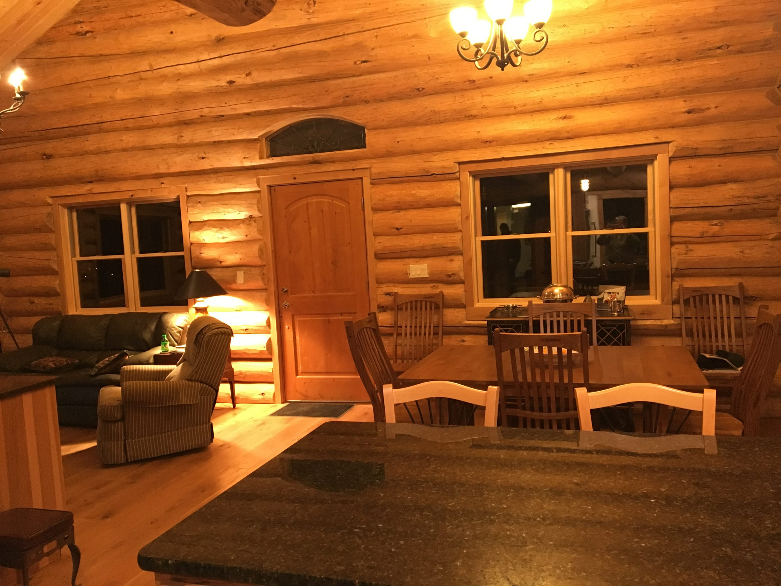 A great room area in a handcrafted log home.