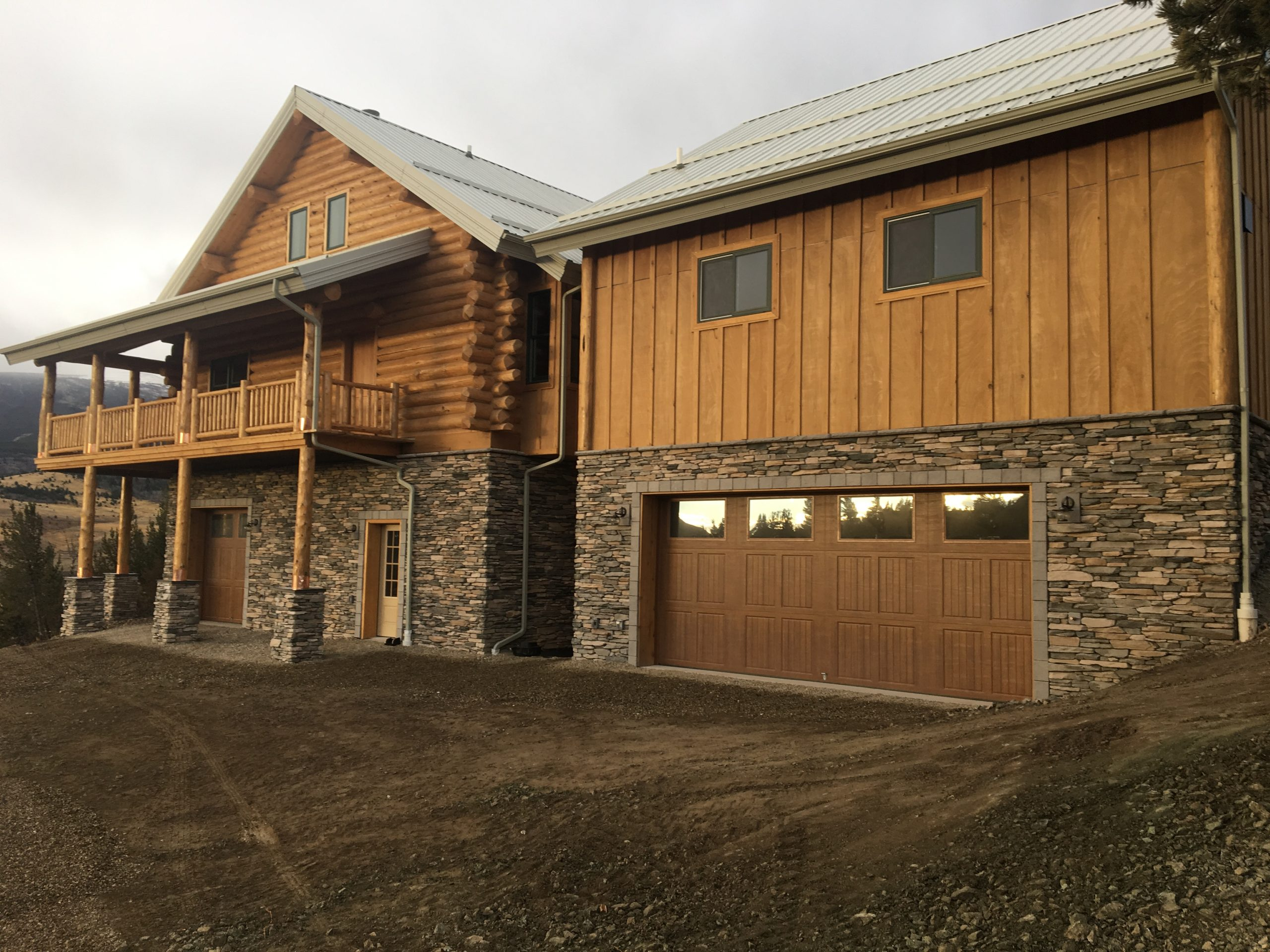 This log home owner has just finished the stone work on the lower level of his home and garage.
