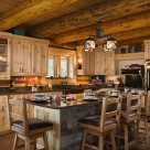 Log home kitchen with pine cabinets