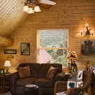 Sitting room in loft of log home