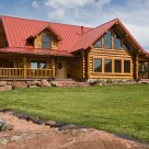 Exterior of custom log home with red roof