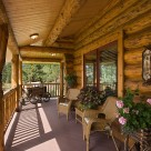 Covered porch of handcrafted log home