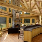Great room in handcrafted log home with prow window wall and log truss