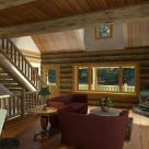 Rendering of log cabin living room with wood stove in corner, log staircase with log rails leading to loft area above and large window viewing out to covered porch.