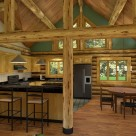 Kitchen and dining room in handcrafted log home