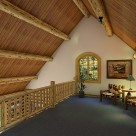 Loft rendering with log rails along loft edge