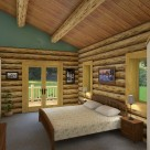 Master bedroom in handcrafted log home