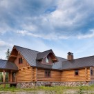 Handcrafted log home with gable dormer viewed from exterior