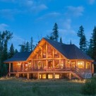 Gorgeous log home exterior at twilight.