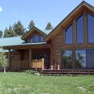 Exterior view of chink style log home with soaring cathedral ceilings and large trapezoid windows in gable of great room.
