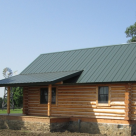 Exterior of small log cabin