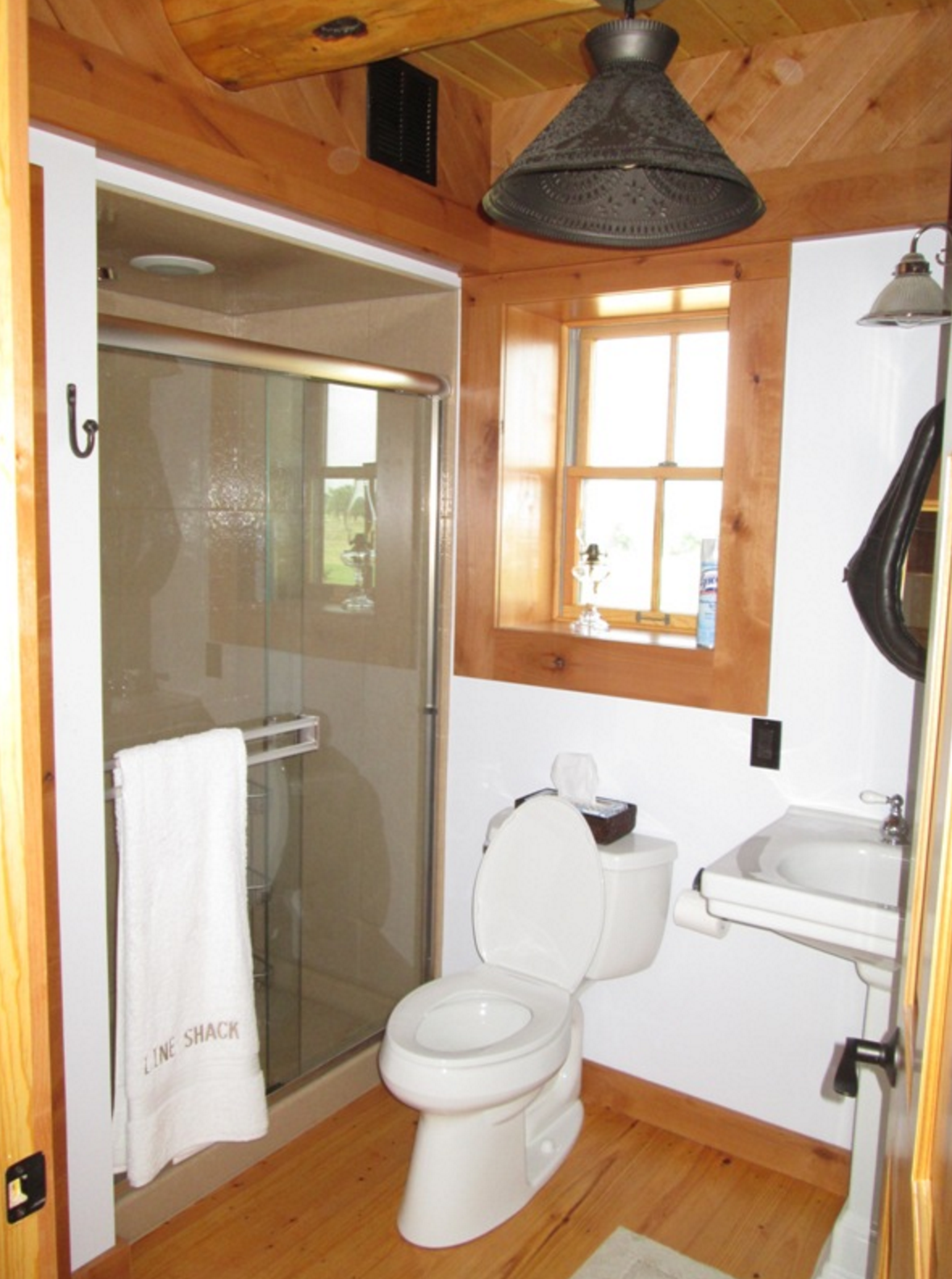 bathroom with pedistal sink and glass shower