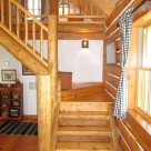 Log staircase in log cabin