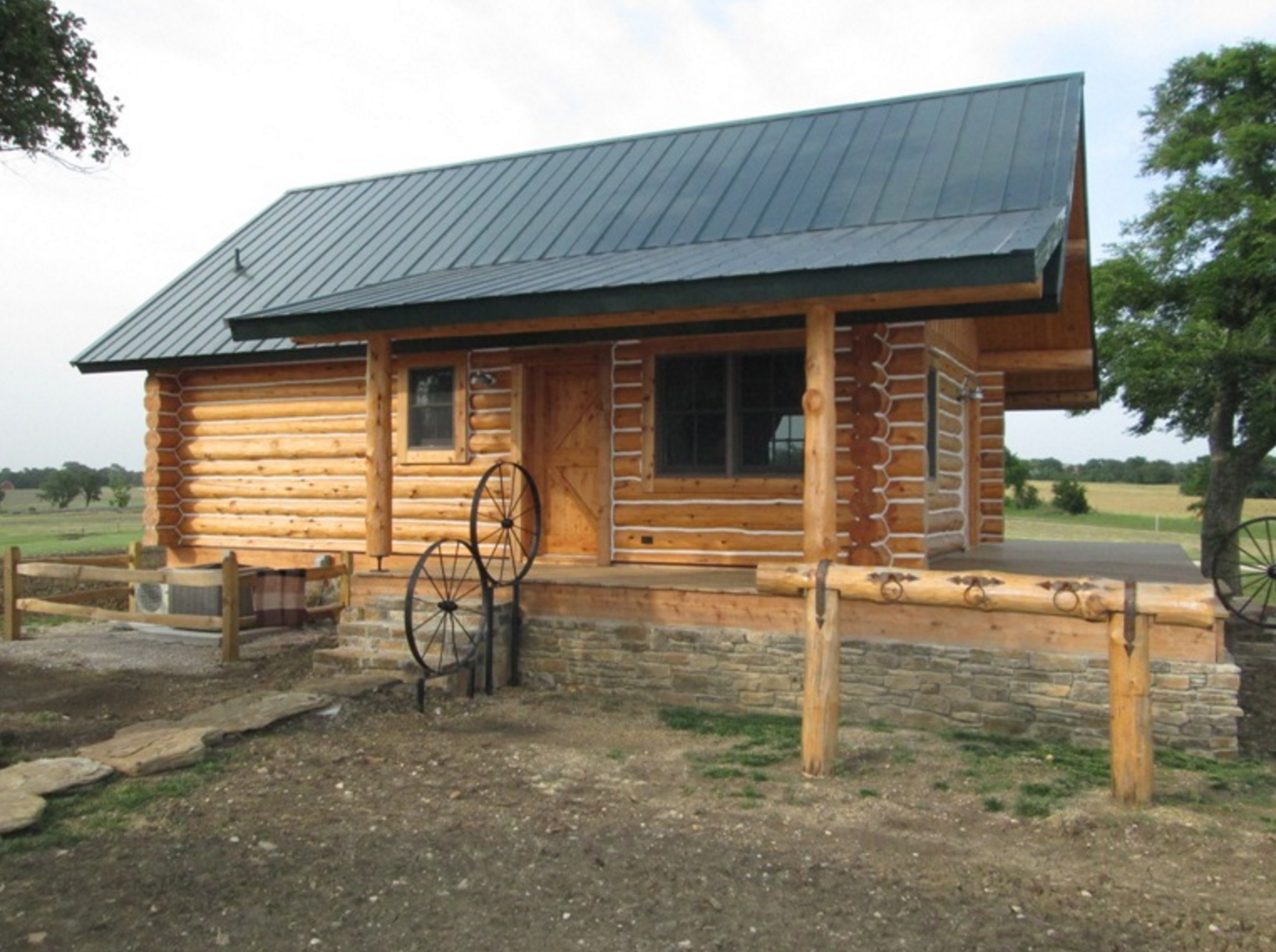 Exterior of log cabin with covered porch
