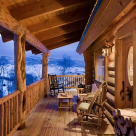 Covered porch with log posts and log railings