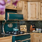Wood cabinets around antique cook stove