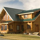 Custom handcrafted log home exterior photo on sunny day.