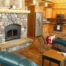 Fireplace insert in log cabin