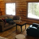 Living room in handcrafted log cabin