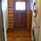 Mudroom in handcrafted log cabin