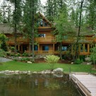 Luxury log home on walk out basement viewed from dock on Swan Lake mt.