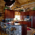 Log home kitchen with breakfast bar and unique bar stools.