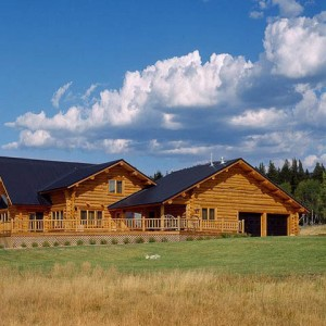 Exterior of handcrafted log home with attached garage