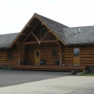 Log home entry with log truss