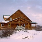 Exterior of custom log home with attached carport and wrap around porches on snowy winter day.