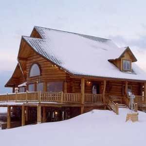 Exterior of handcrafted log home in winter