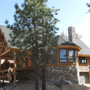 Exterior of log home on stone foundation
