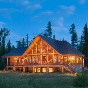 Exterior of custom log home at twilight.
