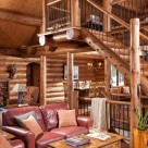 Photo of log staircase with mix of wood and steel railings.