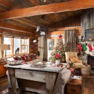 Living room in chinks style log cabin with hand hewn beams and antique furnishings.
