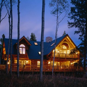 Handcrafted log home exterior at twilight