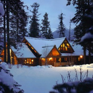 Exterior of custom log home in winter
