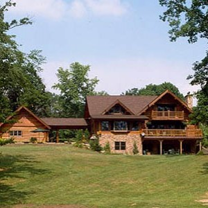 Exterior of log home with breezway to log garage