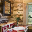 Close up photo of wooden bathroom vanity with red and white checkerboard countertop in custom log home.