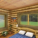 Rendering of log home bedroom with queen bed, blue and white comforter, end tables with lamps and views through windows to forest.