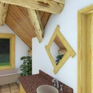 Rendering of clawfoot tub below window in dormer of log home.