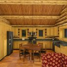 Kitchen and dining in log cabin.