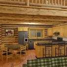 Rendering of custom log home kitchen with breakfast bar and dining table