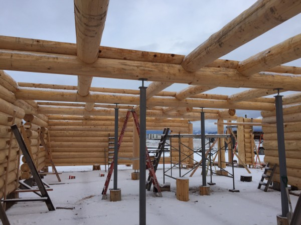 This construction shot shows a oft support system with stringer logs, infills, and log joists.
