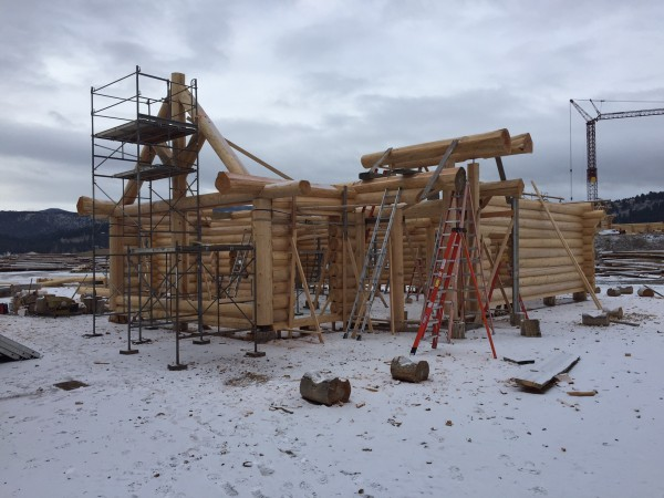 The custom log truss is set and the log roof support systems starts next.