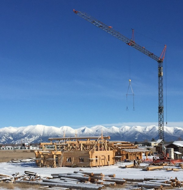 Tower cranes expedite the construction of several log homes in our Kalispell, MT log yard.