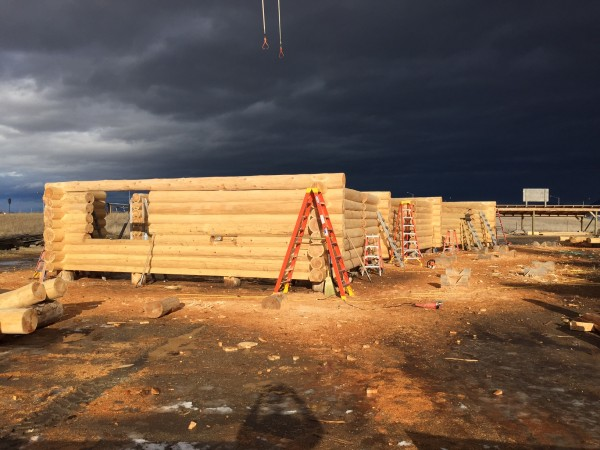 The solidness of the construction of this log home is befitting the stormy weather approaching.