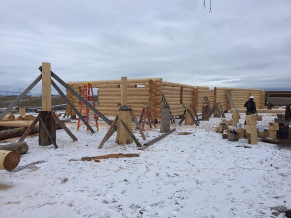 Log columns are being prepared for the handcrafted log breezeway.