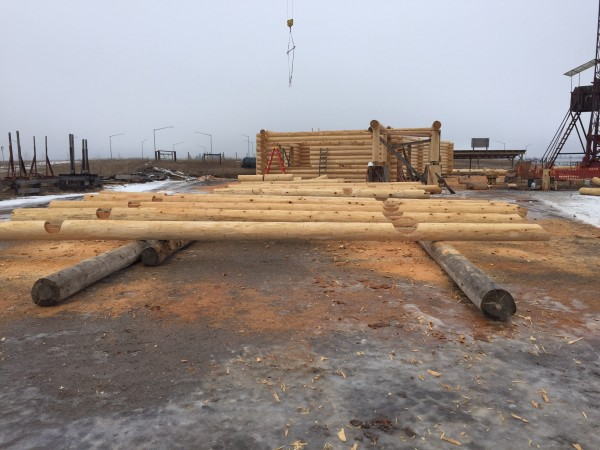 Hidden notches were handscibed and carved into these log floor joists. They are ready to be installed in this handcrafted log shell.