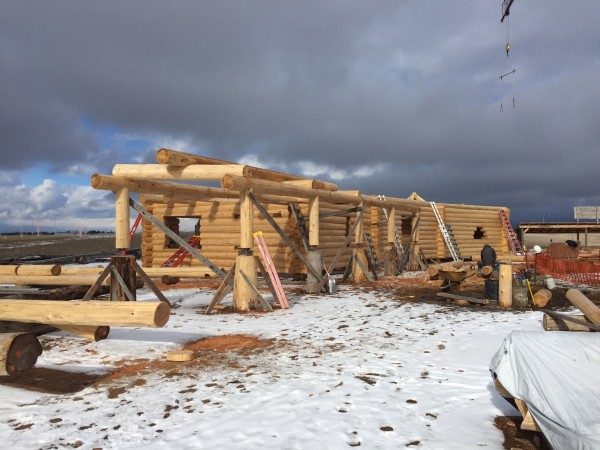 Handcrafted log walls show the progress on this log home.