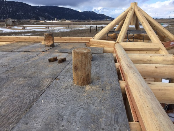 A close up construction shot of the slotting provided for the loft floor in this custom log home package.
